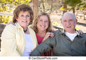 Senior Couple with Daughter in the Park - Portrait of Senior...