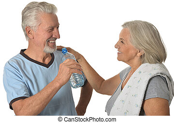 Senior couple  with water after exercising