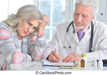 Portrait of senior doctor with elderly patient