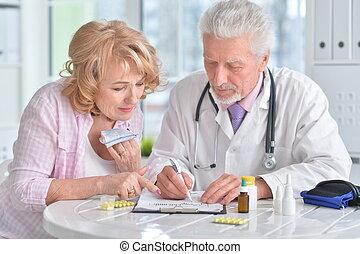 Portrait of senior doctor with elderly patient