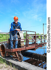 Portrait of senior engineering worker in the water treatment plant