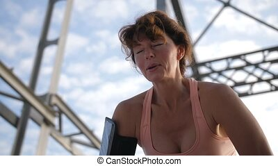 Portrait of senior female breathing after running