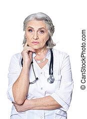Portrait of senior female doctor on white background
