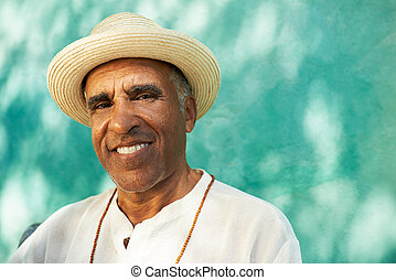 Portrait of senior hispanic man smiling at camera