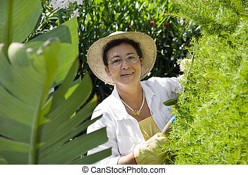 gardening - Portrait of senior Italian woman gardening, ...
