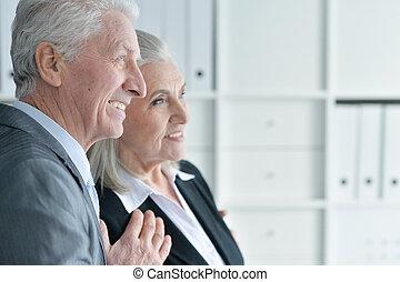 senior man and woman in formal wear - Portrait of senior man...
