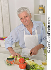 senior man  in the kitchen