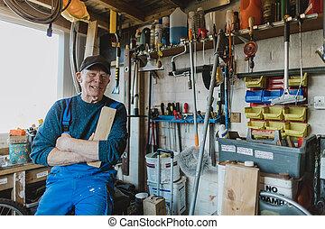 Portrait of Senior Man in Workshop