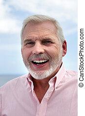 Portrait of senior man laughing
