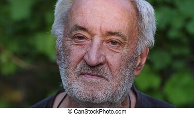 Portrait of senior man on nature