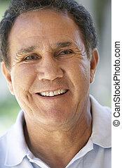 Portrait Of Senior Man Smiling At The Camera