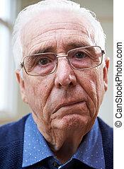 Portrait Of Senior Man Suffering From Stroke
