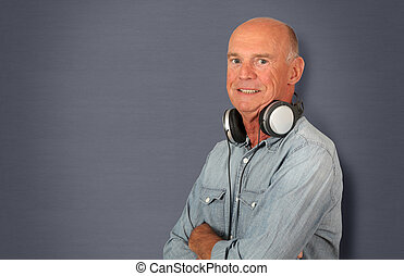 Portrait of senior man with headphones