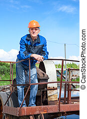 Portrait of senior manual worker in the water treatment plant