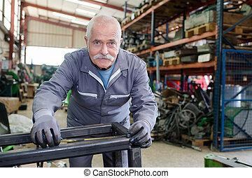 Portrait of senior metalworker