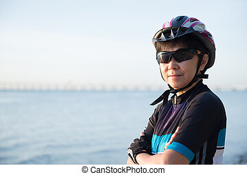 Portrait of senior woman cyclist
