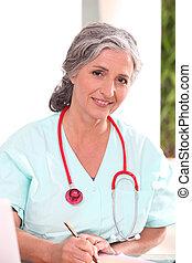Portrait of senior woman doctor