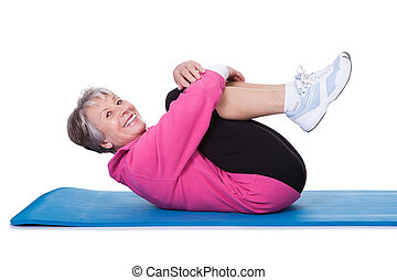 Portrait Of Senior Woman Exercising