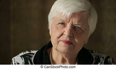 Portrait Of Senior Woman - Lonely old woman looking at...