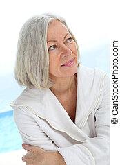 Portrait of senior woman in bathrobe