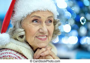 Portrait of senior woman in Santa hat