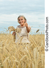 senior woman in summer field