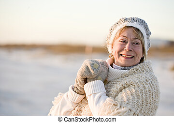Portrait of senior woman in warm winter clothing - Portrait...