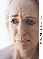 Portrait Of Senior Woman Looking Anxious