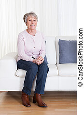 Senior Woman Sitting On The Couch