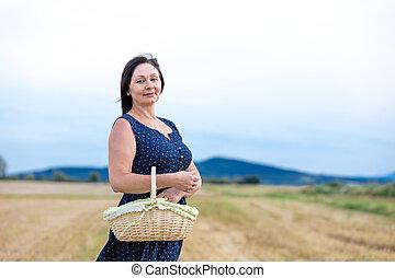 Portrait of senior woman with basket