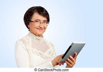Portrait of senior woman with digital tablet
