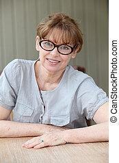 Portrait of senior woman with eyeglasses