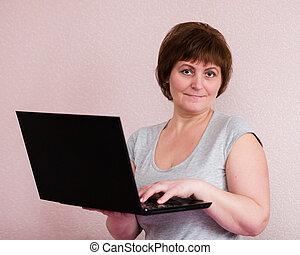 Portrait of senior woman with laptop
