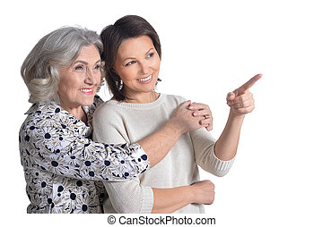 Senior woman with mature daughter