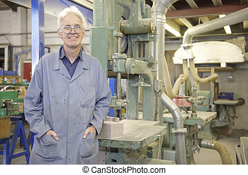 senior worker - portrait of senior worker on factory floor ...