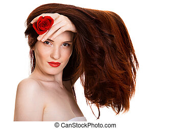 Portrait of sensual beautiful woman with red rose on white background