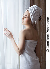 Portrait of sensual woman posing after shower