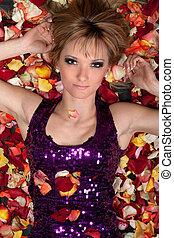 sensual young blonde lying in rose petals