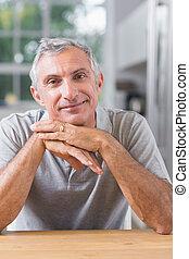 Portrait of serene man looking at camera