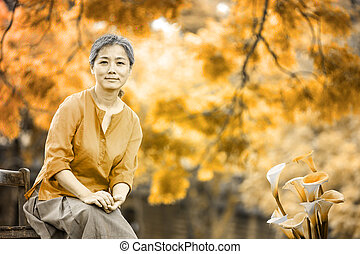 Portrait of serene mature woman in garden for adv or others...