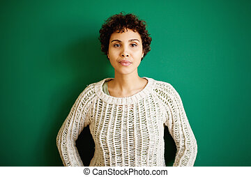 serious african american woman against green background