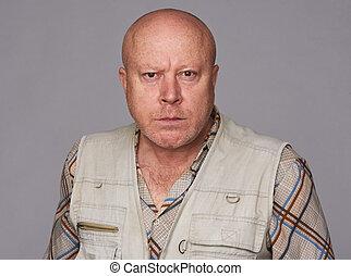 serious bald senior man isolated