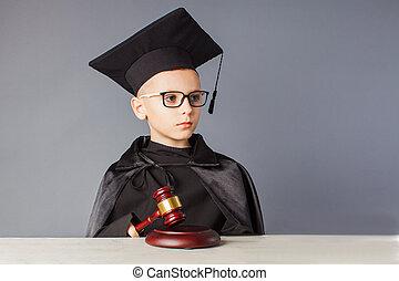 Portrait of serious boy judge makes a decision. Future profession.