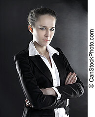portrait of serious business woman .isolated on black background