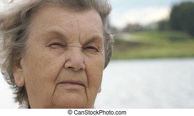 Portrait of serious elderly woman outdoors - Portrait of...
