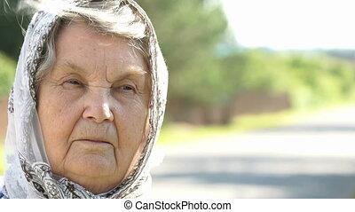 Portrait of serious mature elderly woman. Close-up -...