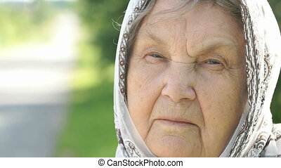 Portrait of serious mature elderly woman. Close-up -...