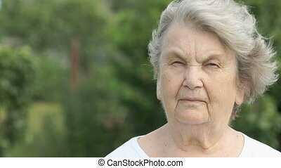Portrait of serious mature elderly woman outdoors - Portrait...