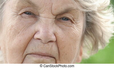Portrait of serious mature old woman. Close-up - Portrait of...