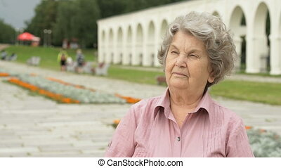 Portrait of serious mature old woman outdoors - Portrait of...